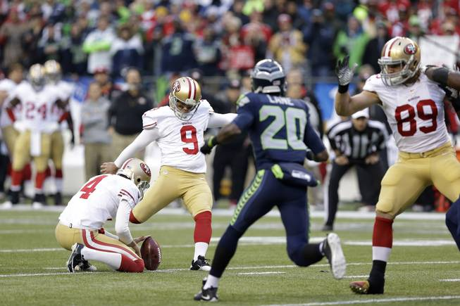 San Francisco 49ers' Phil Dawson (9) works against the Seattle Seahawks  during the first half of the NFL football NFC Championship game Sunday, Jan. 19, 2014, in Seattle. (AP Photo/Elaine Thompson)