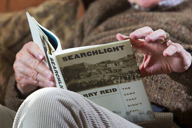 Senate Majority Leader Harry Reid (D-NV) reads from his book on Searchlight, Nev. during an interview at his home in Searchlight Monday Jan. 20, 2014.