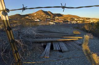 An old mining shaft is shown on a hill in Searchlight, Nev. Monday Jan. 20, 2014.