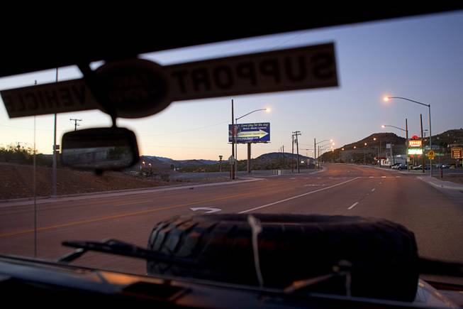 "A view of Searchlight, Nev. is seen through the windshield of the ""Finding Nevada"" Land Rover Monday Jan. 20, 2014."