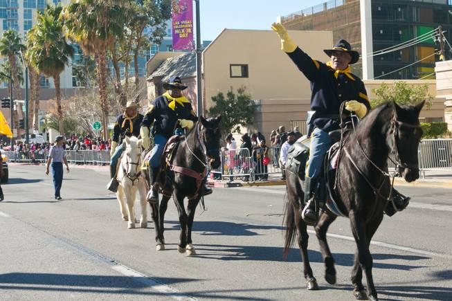 Members of the Buffalo Soldiers of Southern Nevada ride in the 32nd Annual Dr. Martin Luther King Jr. Parade, Monday Jan. 20, 2014.
