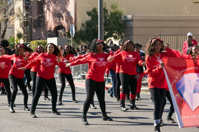 Members of the Delta Gems dance for the crowd during the 32nd Annual Dr. Martin Luther King Jr. Parade, Monday Jan. 20, 2014.