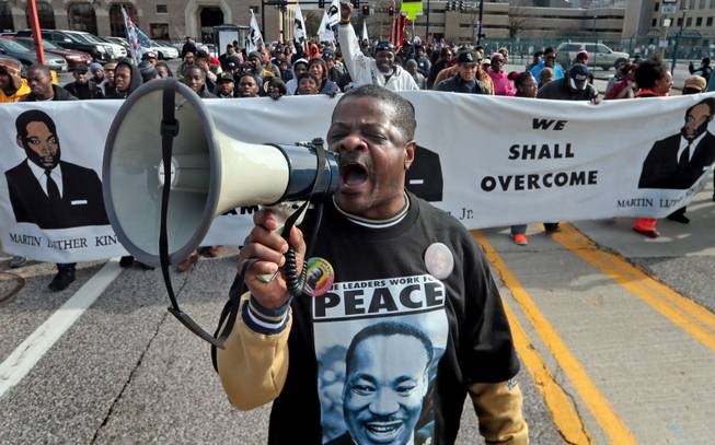 "William Whittaker sparks up the crowd with a chant of ""We are the Marchers,"" during the March of Celebration honoring the Rev. Martin Luther King Jr. and his fight for equality on Monday, Jan. 20, 2014, in St. Louis. ""I have been the voice of the march for the last 28 years. I still believe in the dream,"" said Whittaker."