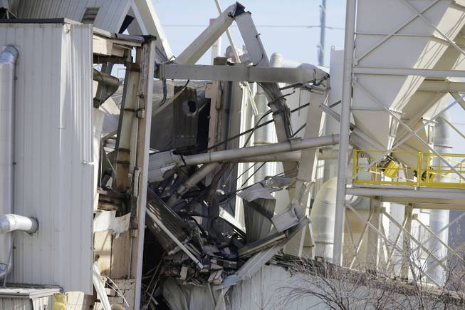 The International Nutrition plant is in wreckage  in Omaha, Neb., where a fire and explosion took place Monday, Jan. 20, 2014.