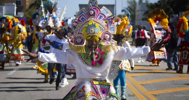 A member of a Caribbean carnival dance group marches in the MLK parade in Miami, Monday, Jan. 20, 2014. Dr. Martin Luther King, Jr. is honored across the country annually on the third Monday in January with Martin Luther King, Jr. Day. He was the most visible figure in the Civil Rights movement.