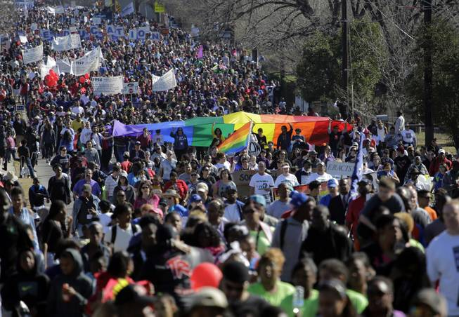 Thousands participate in a march honoring Martin Luther King Jr., Monday,  Jan. 20, 2014, in San Antonio.  Parades and celebrations have been scheduled across Texas to honor Martin Luther King Jr. on the federal holiday in his name.