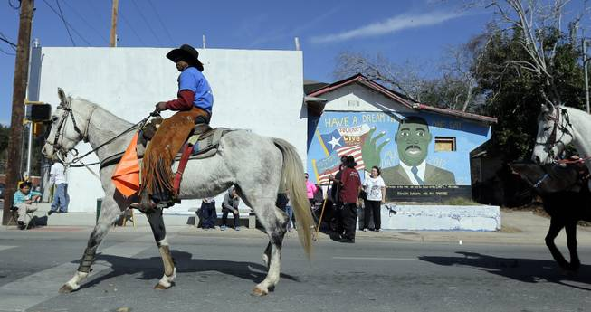 Horse riders take part in a march honoring Martin Luther King Jr., Monday,  Jan. 20, 2014, in San Antonio.  Parades and celebrations have been scheduled across Texas to honor Martin Luther King Jr. on the federal holiday in his name.
