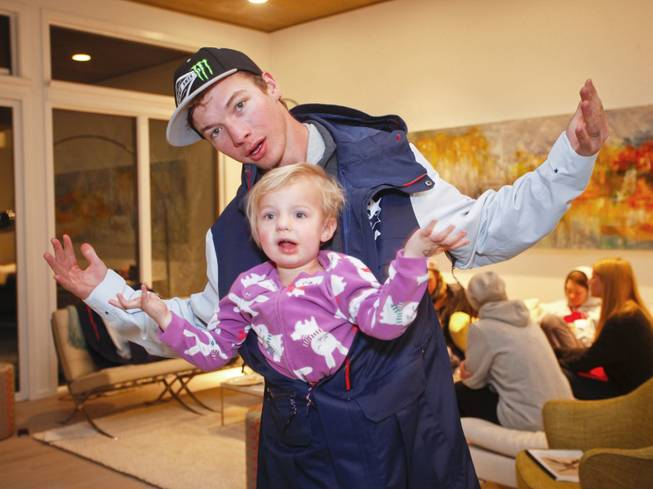 IMAGE DISTRIBUTED FOR THE NORTH FACE - David Wise of Reno, Nevada member of the U.S. Freeskiing Team and his daughter, Nayeli Grace Wise, play around in his new competition uniform from The North Face, while in Aspen, CO this week preparing for the X-Games. Monday, January, 20, 2014 in Aspen, CO. (Photo by Nathan Bilow/Invision for The North Face/AP Images)