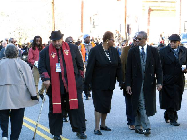 North Carolina NAACP President William Barber, left, interim national  NAACP President Lorraine Miller, center, and South Carolina NAACP President Lonnie Randolph, right, march to the South Carolina Statehouse as part of the King Day at the Dome rally on Monday, Jan. 20, 2014, in Columbia, S.C.