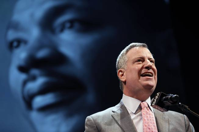 "New York City Mayor Bill de Blasio speaks at a tribute to Martin Luther King, Jr. in the Brooklyn borough of New York, Monday, Jan. 20, 2014. De Blasio told a packed audience Monday at the Brooklyn Academy of Music that the ""price of inequality has deepened."""