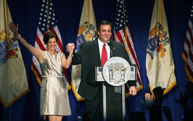 Gov. Chris Christie holds hands with wife Mary Pat Christie as he speaks at an Inauguration event Jan. 19, 2010, in Newark, N.J.