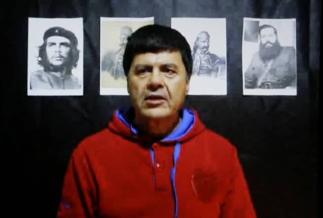 In this Monday, Jan. 20, 2014, screen image, member of the Greek November 17 terrorist group Christodoulos Xiros makes an Internet statement posted Monday and purportedly written by him on Jan. 14 which rails against the Greek financial crisis.
