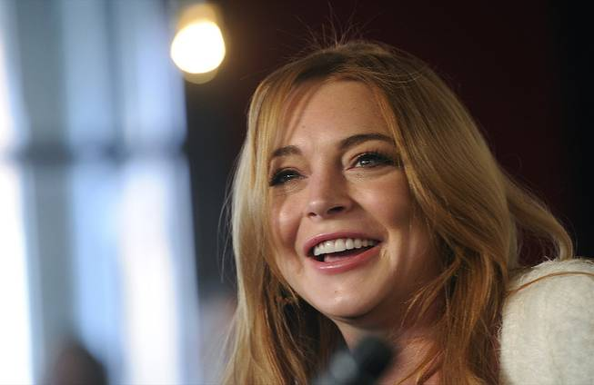 Actress Lindsay Lohan addresses reporters during a news conference at the 2014 Sundance Film Festival on Monday, Jan. 20, 2014, in Park City, Utah.
