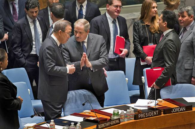 Jordanian Foreign Minister and President of the United Nations Security Council Nasser Judeh, right, has a conversation with U.N. Secretary-General Ban Ki-moon as the Security Council meeting began at U.N. headquarters, Monday, Jan. 20, 2014.