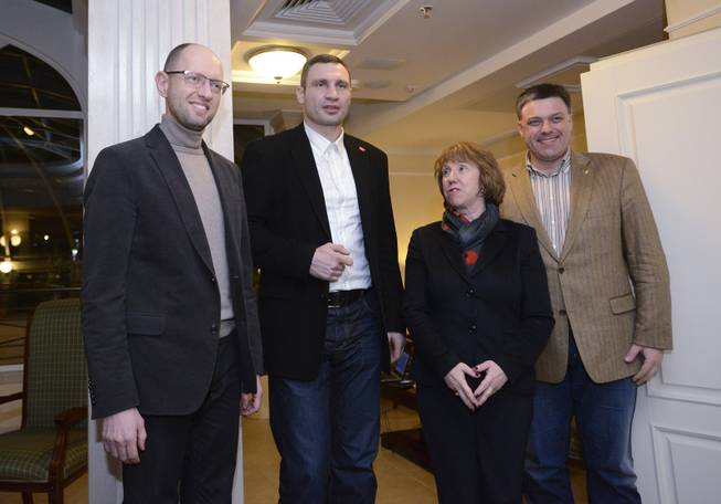 EU foreign policy chief Catherine Ashton, second right, prior her meeting with  Ukrainian opposition leaders, Oleh Tyahnybok, right, Arseniy Yatsenyuk, left, and Vitali Klitschko, second left,  in Kiev, Ukraine, Tuesday, Dec. 10, 2013. Top Western diplomats headed to Kiev Tuesday to try to defuse a stand-off between President Viktor Yanukovych's government and thousands of demonstrators, following a night in which police in riot gear dismantled protesters' encampments outside government buildings. Demonstrators have occupied the Ukrainian capital for weeks opposing Yanukovych's decision to freeze ties with the European Union and tilt to Russia instead.