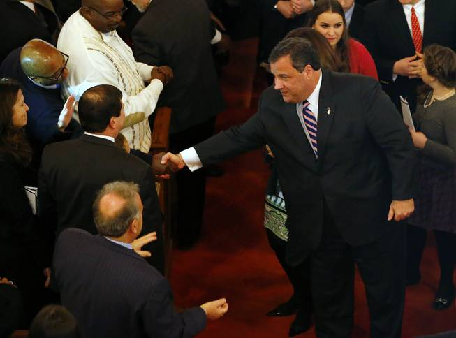 New Jersey Gov. Chris Christie shakes hands as he leaves a prayer service in celebration of his inauguration at the New Hope Baptist Church on Tuesday, Jan. 21, 2014, in Newark.