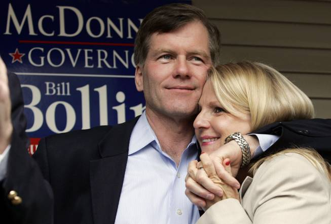 In this Oct. 31, 2009, file photo, Republican gubernatorial candidate Bob McDonnell, hugs his wife, Maureen, during a rally in Richmond, Va. McDonnell and his wife were indicted Tuesday, Jan. 21, 2014, on corruption charges after a  federal investigation into gifts the Republican received from a political donor.