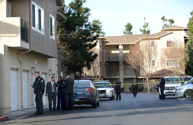 Law enforcement officers investigate the accidental fatal shooting of a Bay Area Rapid Transit police officer by a fellow BART officer while serving a warrant at an apartment building, according to officials, Tuesday, Jan. 21, 2014, in Dublin, Calif.