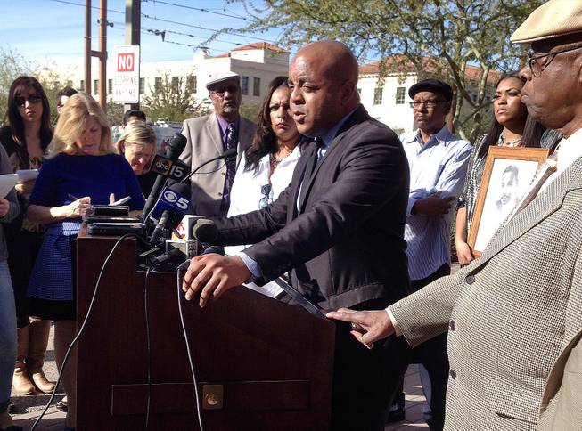 The Rev. Jarrett Maupin, center, an Arizona civil rights activist, speaks during a news conference in Phoenix, Tuesday, Jan. 21, 2014, after an Arizona State University fraternity hosted a distasteful party in commemoration of Martin Luther King Jr. Day, replete with racist stereotypes and offensive costumes.