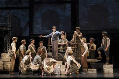 "In this theater image released by Disney Theatricals, the cast of The Paper Mill Playhouse Production of ""Newsies,"" starring Jeremy Jordan, center, is shown in New York."
