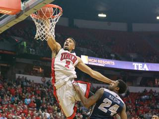 UNLV forward Khem Birch dunks over Utah State guard Jo Jo McGlaston during their game Wednesday, Jan. 22, 2014 at the Thomas & Mack Center.