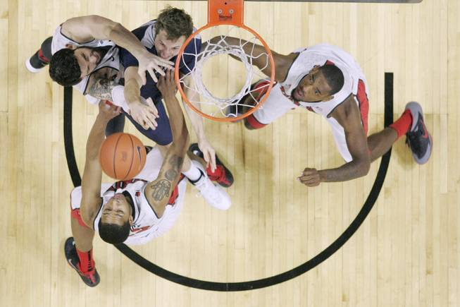UNLV's Carlos Lopez Sosa, Jelan Kendrick and Roscoe Smith fight Utah State forward Ben Clifford for a rebound during their game Wednesday, Jan. 22, 2014 at the Thomas & Mack Center. UNLV won 62-42.