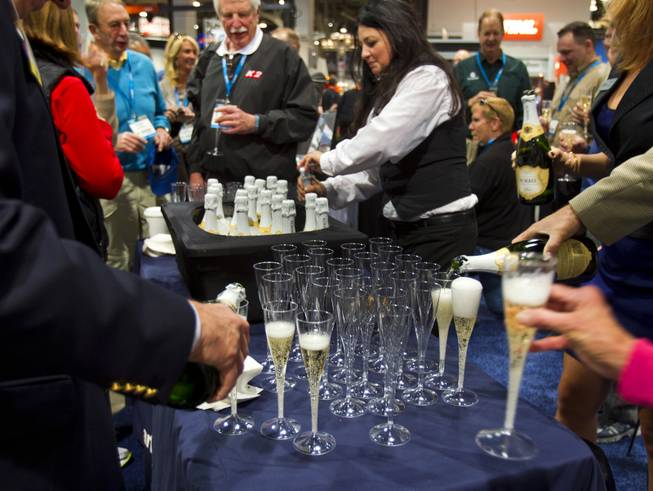 Champagne is poured as Concrete Openings Magazine gives out show awards during the 40th anniversary of the World Of Concrete at the Las Vegas Convention Center on Wednesday, Jan. 22, 2014.