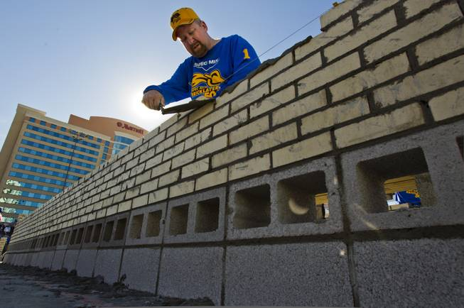 "Last year's winner Fred Campbell from Limestone, Tenn., continues to build a solid wall during the Spec Mix ""Bricklayer 500""   competition at the 40th anniversary of the World Of Concrete event outside the Las Vegas Convention Center on Wednesday, Jan. 22, 2014."