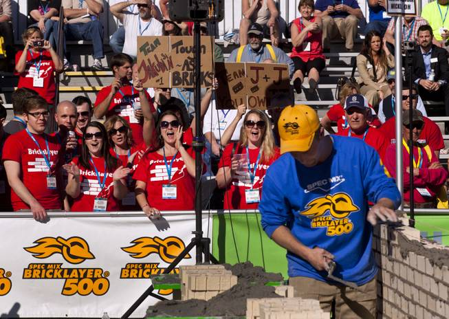 "Fans cheer on Team Jakubin as time winds down during the Spec Mix ""Bricklayer 500""   competition at the 40th anniversary of the World Of Concrete event outside the Las Vegas Convention Center on Wednesday, Jan. 22, 2014."