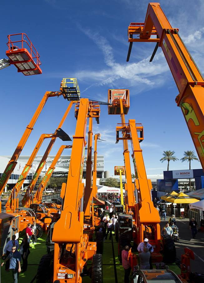 A collection of Snorkel Lifts are on display during the 40th anniversary of the World Of Concrete event outside the Las Vegas Convention Center on Wednesday, Jan. 22, 2014.