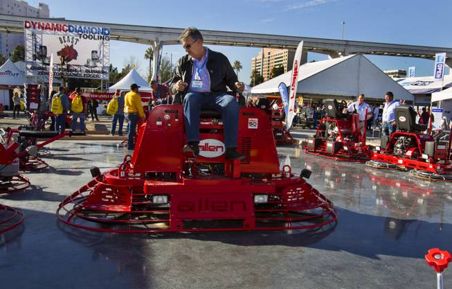 An Allen Engineering concrete paver is operated while sitting atop twin blades during 40th anniversary of the World Of Concrete at the Las Vegas Convention Center on Wednesday, Jan. 22, 2014.
