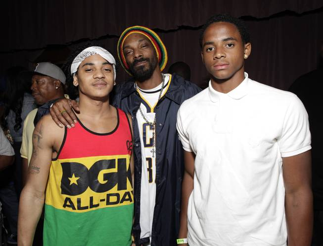 Snoop Dogg with his sons Corde Broadus, left, and Cordell Broadus, right, arrive at the Mac and Devin Go to High School DVD Preview featuring Snoop Dogg and Wiz Khalifa on Monday, June 11, 2012, in Los Angeles.