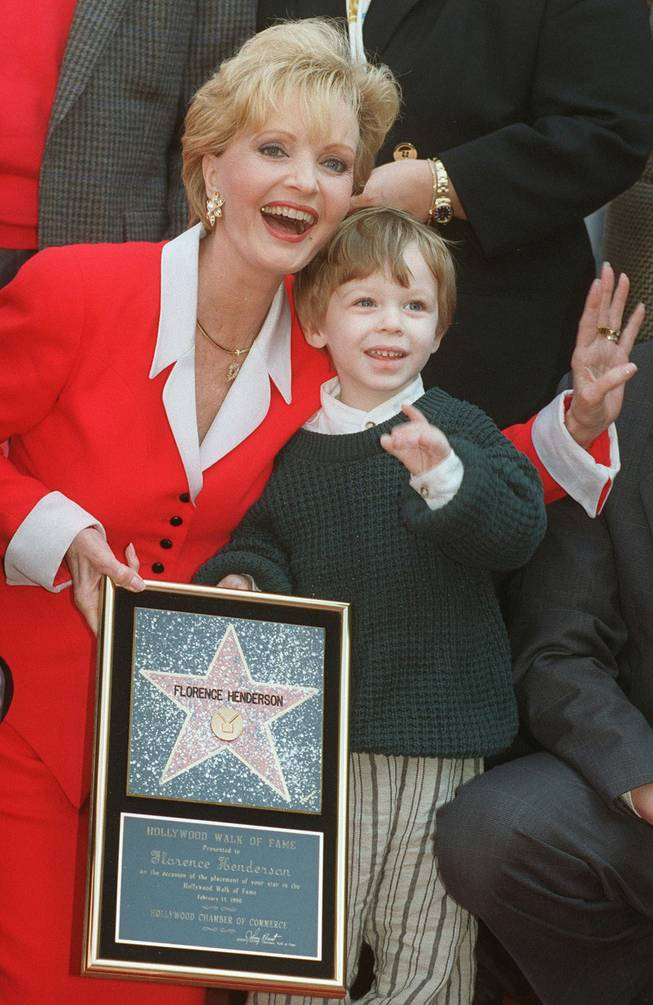 "Actress Florence Henderson celebrates receiving the 2,061st star on the Hollywood Walk of Fame with her grandson Kyle Russell, 2, Wednesday, Feb. 14, 1996, in the Hollywood section of Los Angeles. Henderson, well-known for her role as Carol Brady on television's ""The Brady Bunch,"" also celebrated her birthday on Wednesday."