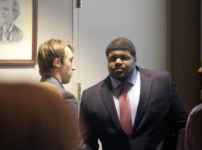 Former Dallas Cowboys player Josh Brent, right, stands with Dallas Cowboys linebacker Sean Lee in court after closing arguments in his intoxication manslaughter trial Tuesday, Jan. 21, 2014, in Dallas.