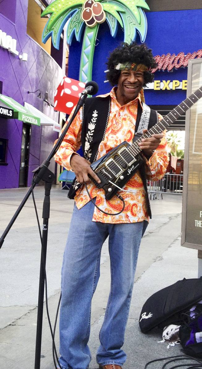Lenny Payne plays Jimi Hendrix in front of Slotzilla in Fremont street experience Wednesday, Jan. 22. 2014.