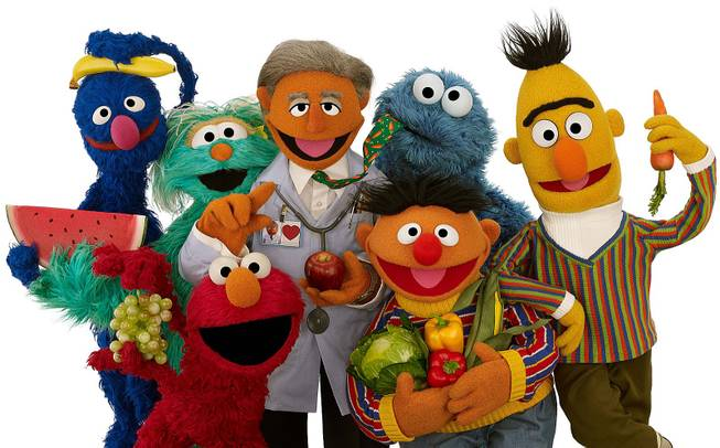 Muppet Dr. Ruster, center, is shown with, from left, Grover, Rosita, Elmo, Cookie Monster, Ernie and Bert. Dr. Valentin Fuster, a cardiologist at New York's Mount Sinai Hospital who Dr. Ruster is based on, teamed up with Sesame Street on a project to improve kids' health.