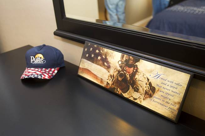 "Patriotic decor is shown in a bedroom during a new home dedication for Army Sgt. Christopher Bales and his family at the Coldwater Crossing subdivision in the Mountain's Edge master planned community Thursday Jan. 23, 2014. Pulte Homes, along with other companies, presented the home to Bales as part of Operation Finally Home,"" an organization which provides homes to veterans and the families of fallen servicemen."