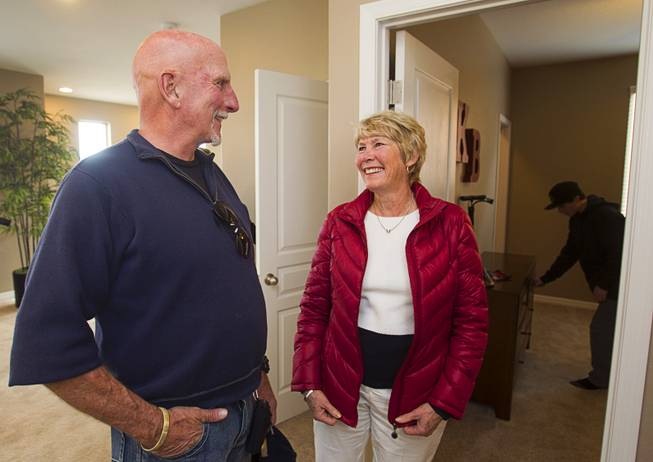"Don Bales and his wife Janna smiles as their grandson Keenan Bales, 14, looks over a bedroom during a new home dedication for Army Sgt. Christopher Bales and his family at the Coldwater Crossing subdivision in the Mountain's Edge master planned community Thursday Jan. 23, 2014. Pulte Homes, along with other companies, presented the home to Bales as part of Operation Finally Home,"" an organization which provides homes to veterans and the families of fallen servicemen."