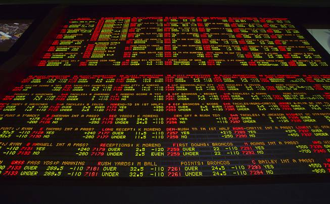 Super Bowl XLVIII proposition bets are posted on an electronic display board at the LVH Superbook on Thursday, Jan. 23, 2014.