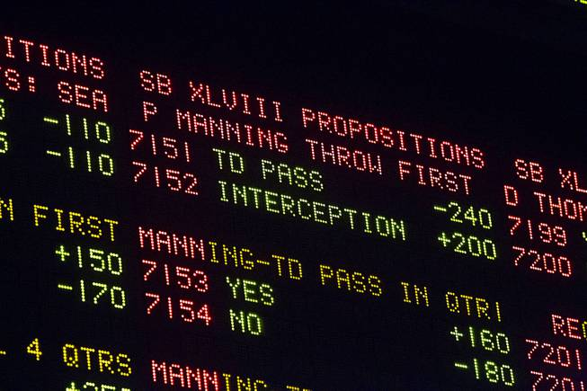 Super Bowl XLVIII proposition bets are posted on an electronic board at the Las Vegas Hotel Superbook Thursday Jan. 23, 2014.