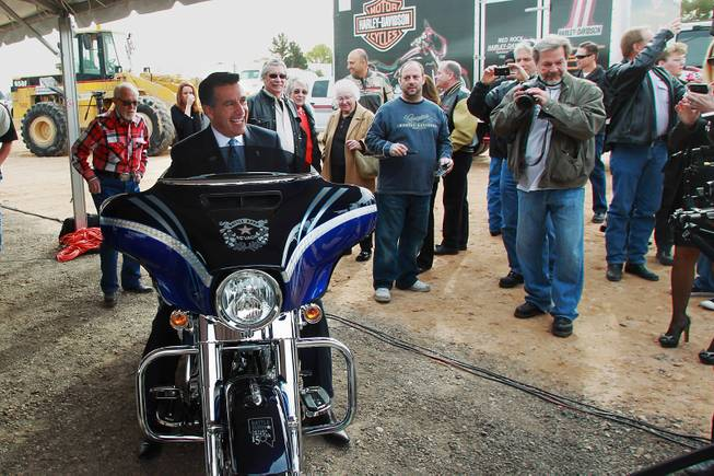 Governor Brian Sandoval sits on a Harley Davidson motorcycle that has been customized for Nevada's sesquicentennial at an event to mark the beginning of construction of a Harley Davidson dealership on the Strip Thursday, Jan. 23, 2014. The dealership will be located on the east side of the Strip, just south of Russell Road.