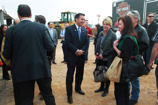 Governor Brian Sandoval talks with guests at an event to mark the beginning of construction of a Harley Davidson dealership on the Strip Thursday, Jan. 23, 2014. The dealership will be located on the east side of the Strip, just south of Russell Road.
