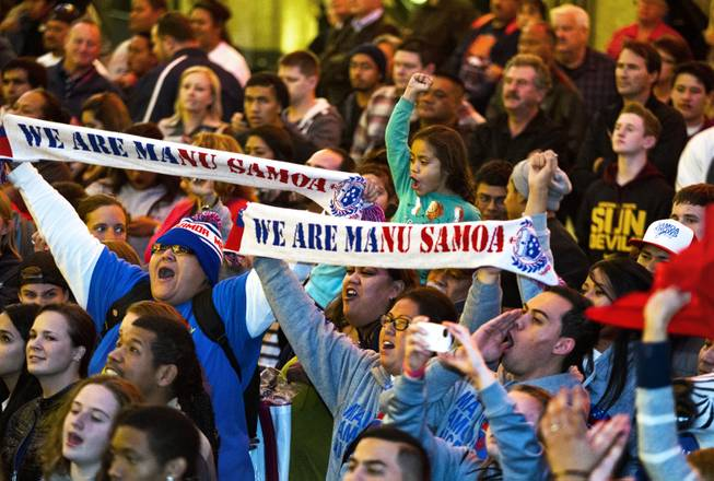 USA Sevens International Rugby Tournament fans for team Samoa cheer for their players during opening ceremonies at the Fremont Street Experience on Thursday, Jan. 23, 2014.