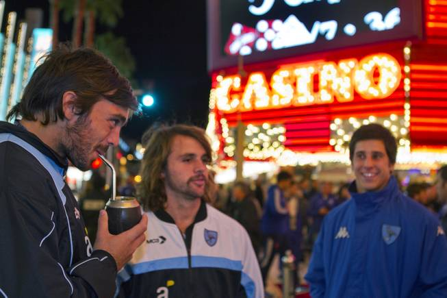 Players from Uruguay drink mate as they arrive at Casino Center preceding a parade for the USA Sevens International Rugby Tournament  players held at the Fremont Street Experience on Thursday, Jan. 23, 2014.