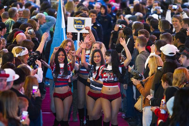 The USA Sevens cheerleaders lead a parade for the USA Sevens International Rugby Tournament players during opening ceremonies at the Fremont Street Experience on Thursday, Jan. 23, 2014.