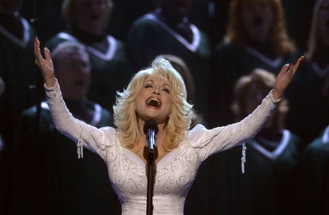 "Dolly Parton performs the song ""Hello God"" with the help of a church choir at the 2002 Country Music Association Awards on Wednesday, Nov. 6, 2002, in Nashville."