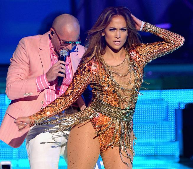 "Jennifer Lopez and Pitbull perform during the awards for ""Premios Juventud"" held at the BankUnited Center at the University of Miami in Coral Gables, Fla., July 18, 2013."
