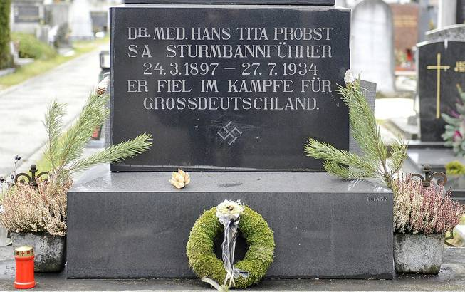 "This picture taken Tuesday, Jan. 21, 2014, shows a marble tombstone which is adorned by a swastika and the inscription ""He died in the struggle for a Great Germany"" at the central cemetery in Graz, Austria."