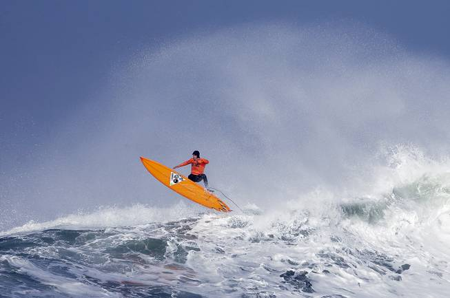 Tyler Fox flies out of a wave during the second heat of the first round of the Mavericks Invitational big wave surf contest Friday, Jan. 24, 2014, in Half Moon Bay, Calif.