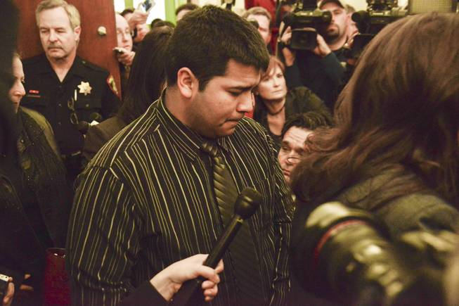 Erick Munoz, husband of Marlise Munoz, is escorted out of court by his attorney Heather L. King, right, Friday, Jan. 24, 2014 in Fort Worth, Texas. The court ruled in Munoz's favor and to remove his brain-dead pregnant wife from life support.